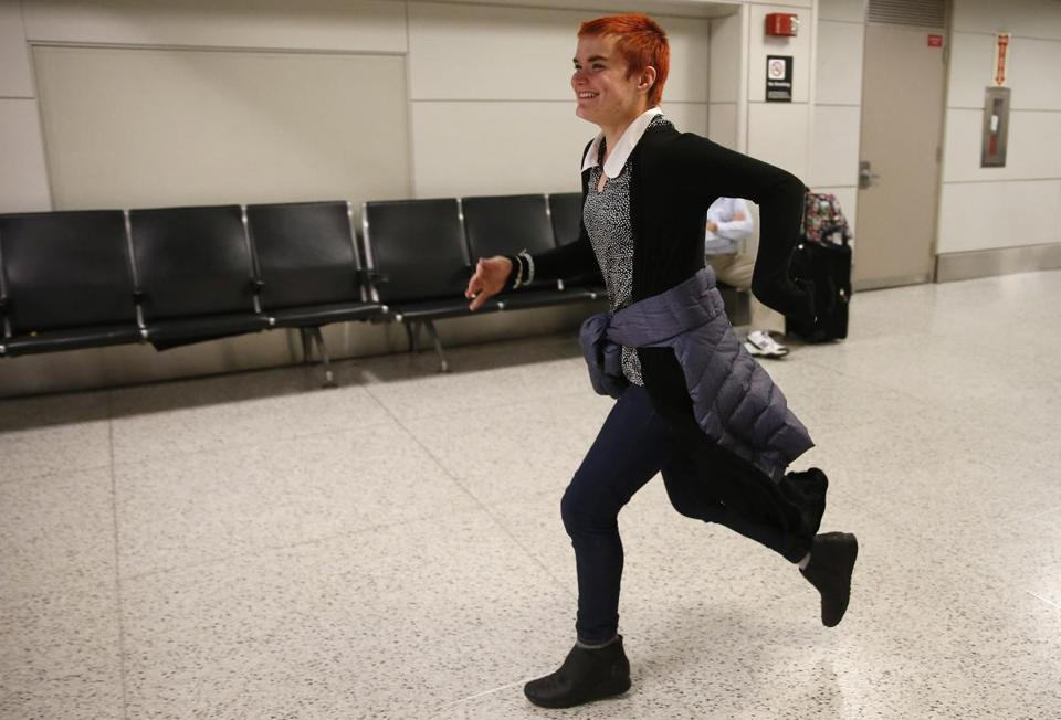 Marina Barry of Hanover, N.H., ran through Terminal C toward her friend Stefania Mennella as she arrived from Orlando at Logan Airport.